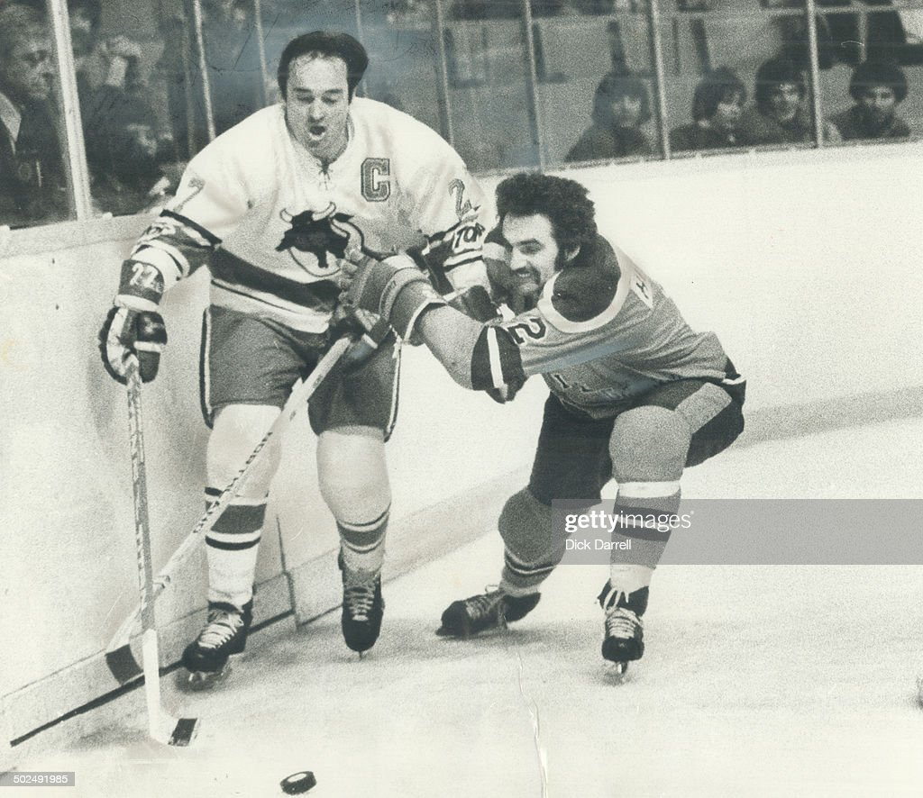 Big m stopped: Frank Mahovlich of Toronto Toros is pushed against boards by defenceman Brent Hughes  : News Photo