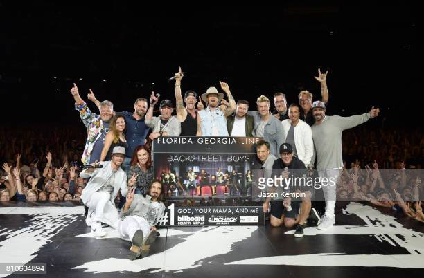 Big Machine Label Group surprises Florida Georgia Line and Backstreet Boys with a plaque to celebrate their No 1 song 'God Your Mama And Me' at FGL's...