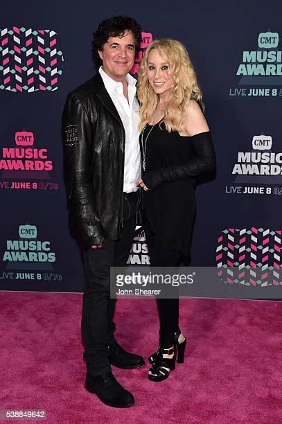 Big Machine Label Group's Scott and Sandi Spika Borchetta attend the 2016 CMT Music awards at the Bridgestone Arena on June 8 2016 in Nashville...