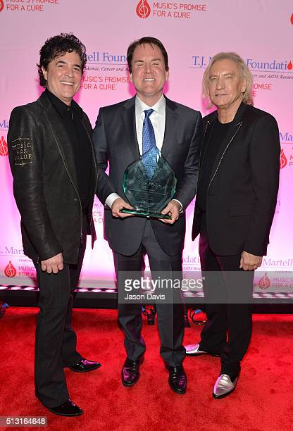 Big Machine Label Group's Scott Borchetta and Joe Walsh of The Eagles celebrate with Frances Preston Outstanding Music Industry Achievement Award...