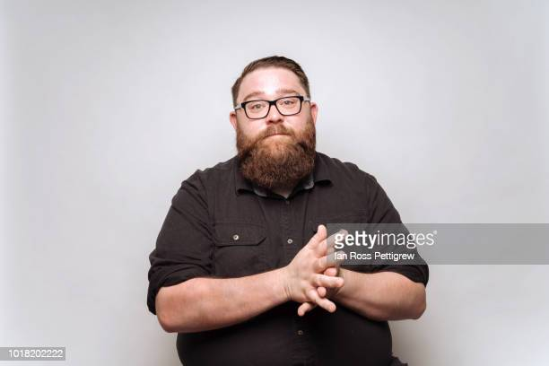 Big man with beard and glasses