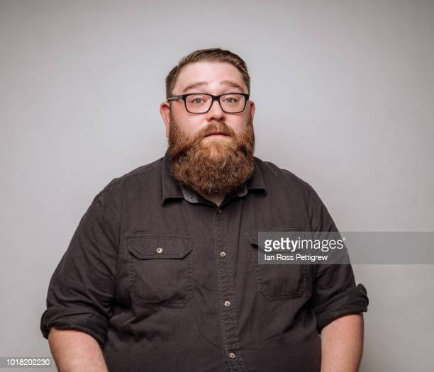 big man with beard and glasses - beard stock pictures, royalty-free photos & images