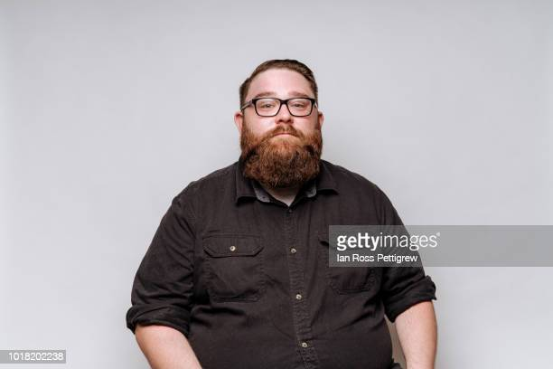 big man with beard and glasses - black shirt stock pictures, royalty-free photos & images