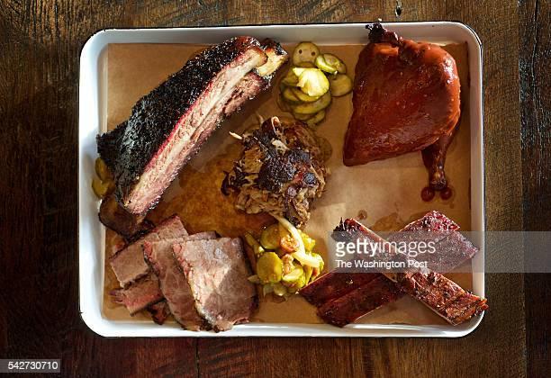 ARLINGTON VA Big meat platter with Brisket Pulled Pork Pork Spare Ribs Beef Short Rib and Chicken photographed in Arlington VA