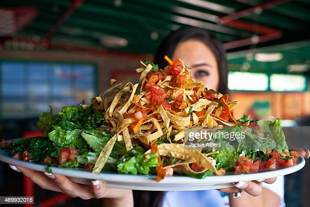 big mexican style salad with tortilla strips - tucson stock pictures, royalty-free photos & images