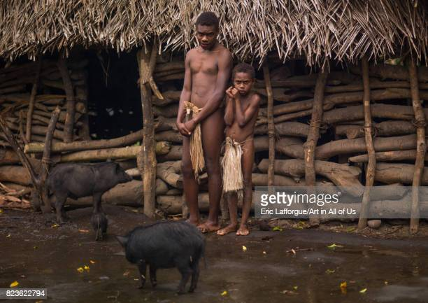 Big Nambas tribe people with their pigs in front of their house Tanna island Yakel Vanuatu on September 6 2007 in Yakel Vanuatu