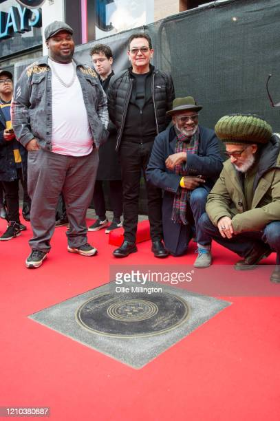 Big Narstie Jon Moss Lynval Golding and Don Letts look on during the Music Walk Of Fame Amy Winehouse stone unveiling the third stone to be placed on...