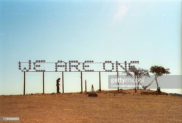 Big neon sign in the middle of a desert place