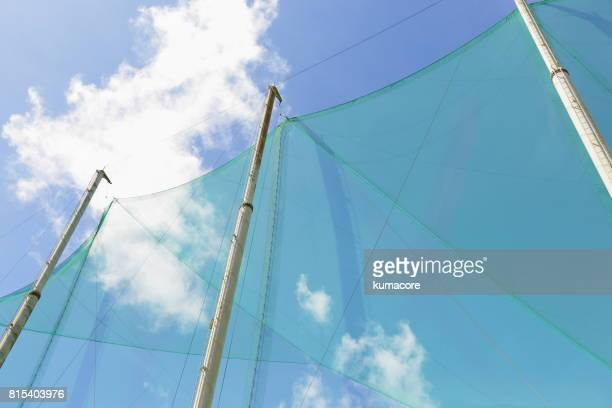 big net of golf practice range - driving range stock pictures, royalty-free photos & images