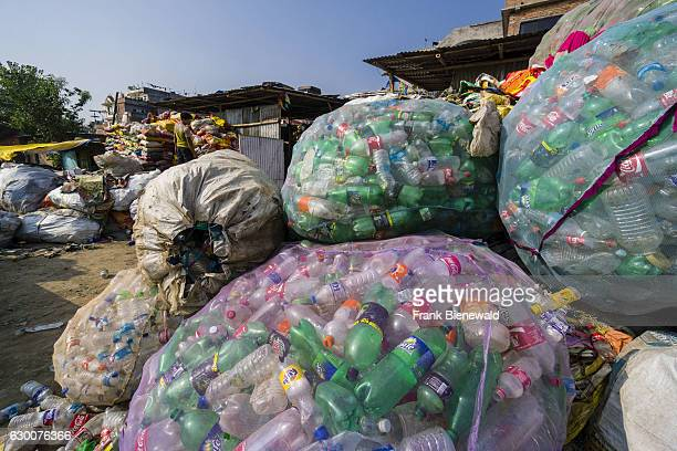 Big nets full of empty plastic bottles collected in the city for recycling