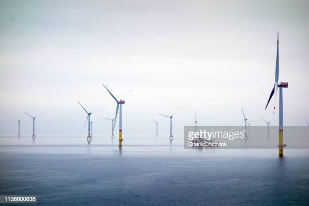 big offshore wind-farm with transfer vessel - wind power stock pictures, royalty-free photos & images