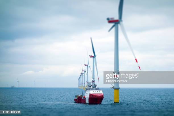 big offshore wind-farm with transfer vessel - wind stock pictures, royalty-free photos & images