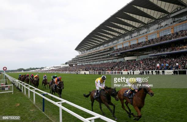 Big Orange ridden by jockey James Doyle leads first time past the post in the Gold Cup during day three of Royal Ascot at Ascot Racecourse