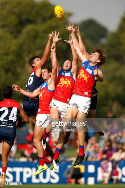 Big pack of playeres compete for the ball during the 2019 JLT Community Series AFL match between the Melbourne Demons and the Brisbane Lions at Casey...