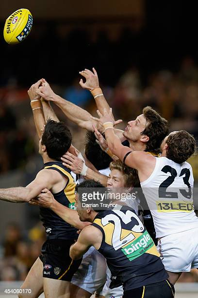 A big pack of players jump at the ball during the round 22 AFL match between the Richmond Tigers and the St Kilda Saints at Melbourne Cricket Ground...