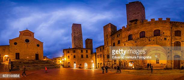 Big panorama of the Piazza del Duomo in San Gimignano, Italy at blue hour