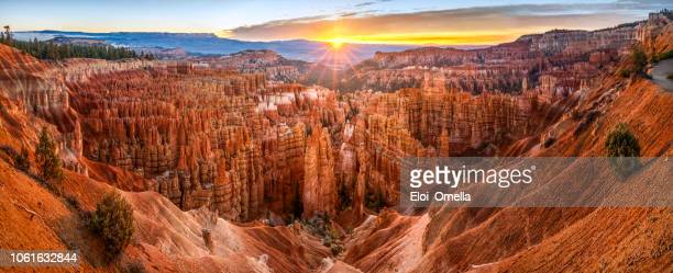 big panoramic photo of sunrise in bryce canyon national park. utah, usa. - canyon stock pictures, royalty-free photos & images