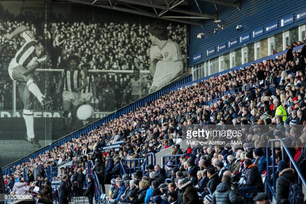 A big picture of Cyrille Regis is seen looking over fans at The Hawthorns home stadium of West Bromwich Albion during the Cyrille Regis Memorial...