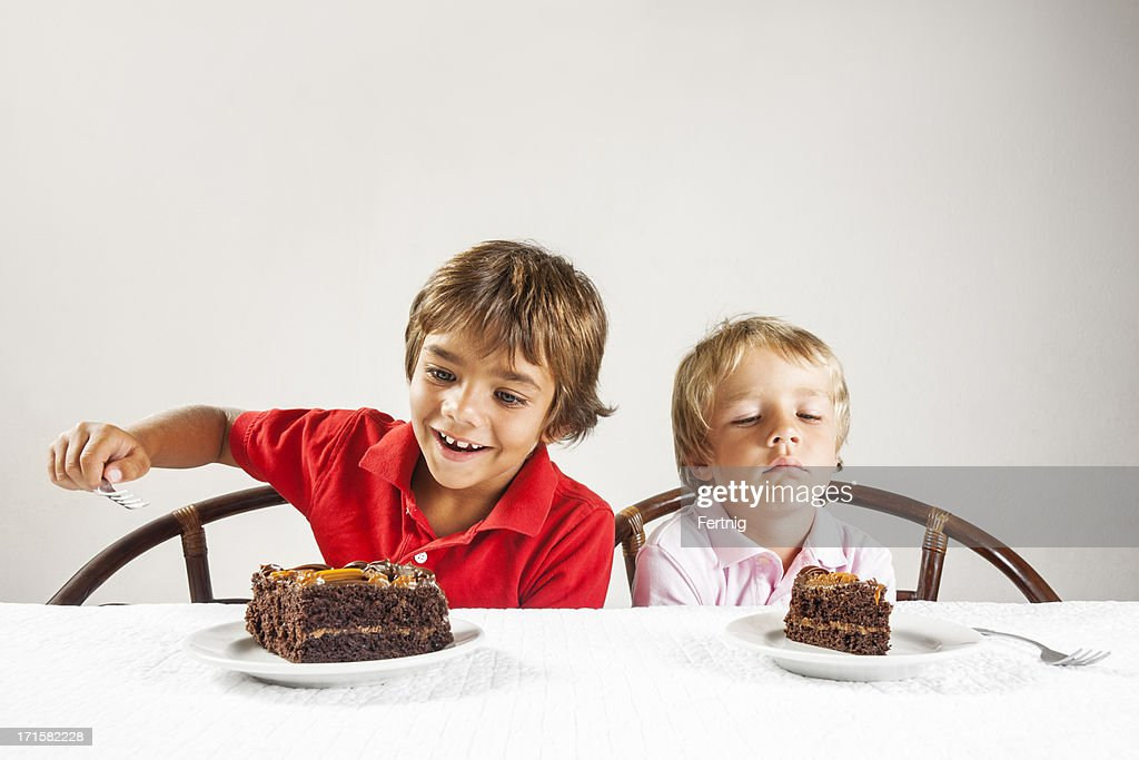 Big piece of cake and a little one, inequality concept. : Stock Photo