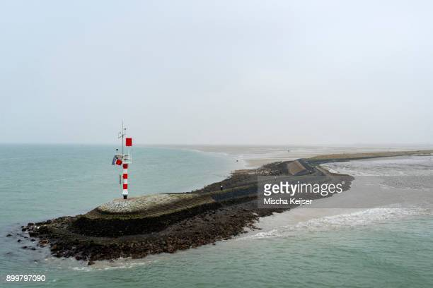 Big pier protecting the harbour from the strong current, West-Terschelling, Friesland, Netherlands, Europe