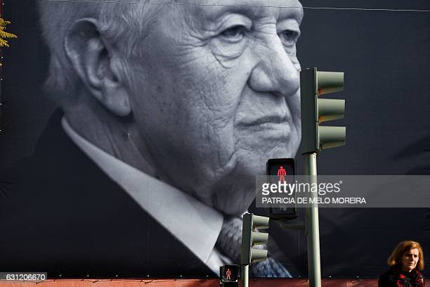 TOPSHOT A big portrait of the historic socialist leader and former Portuguese President Mario Soares is displayed on a facade of the Portuguese...
