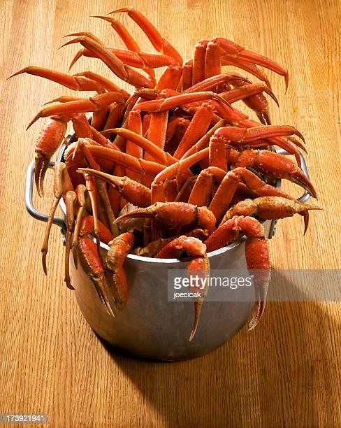 big pot of snow crab - crab leg stock photos and pictures