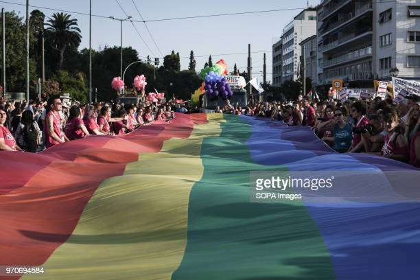 A big pride flag with rainbow colors seen at the festival This year's Pride theme was discrimination against women with transnational women receiving...