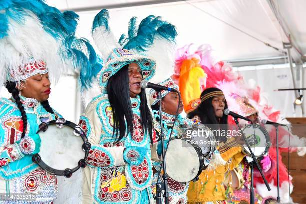 Big Queen Wynoka Boudreaux, Big Chief Monk Boudreaux, Chellene Bailey and Marwan Pleasant of the Golden Eagles Mardi Gras Indians perform during the...