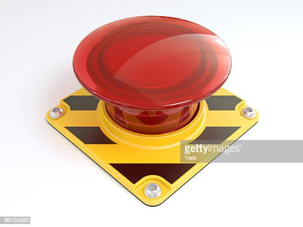 Big red button on yellow and black metal on white background