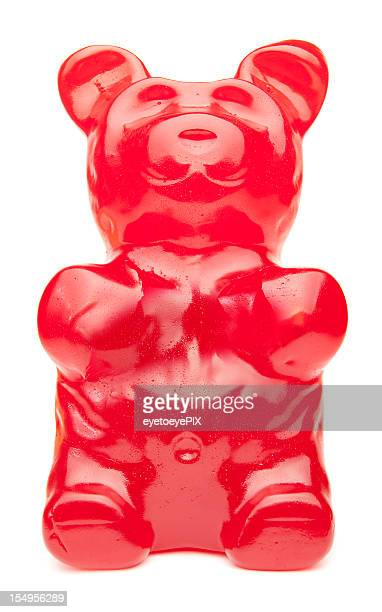 big red gummy bear - gummi bears stock photos and pictures