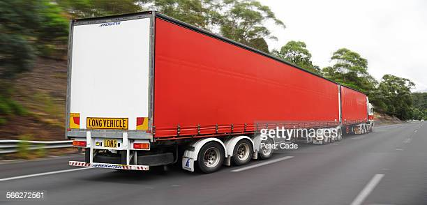 big red lorry on highway.