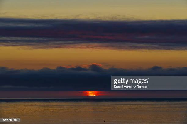 Big red sun at sunset in the sea. Galicia. Spain