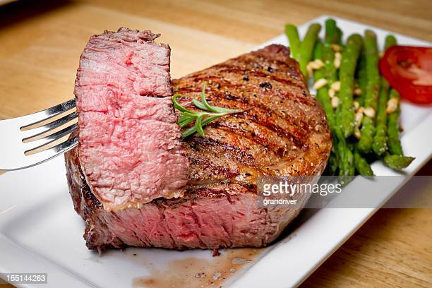 big rib eye steak with bite cut out - franse cultuur stockfoto's en -beelden