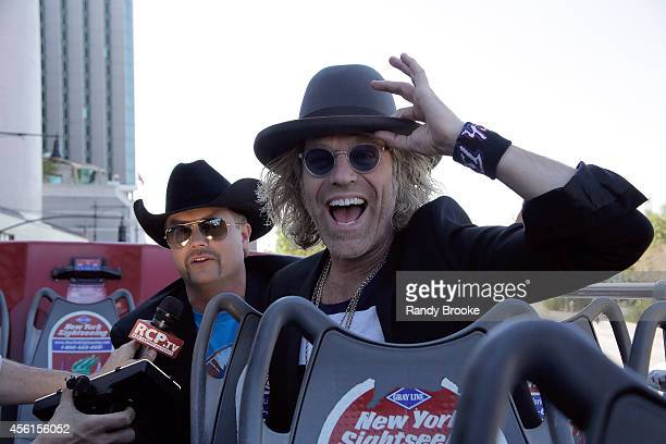 Big Rich John Rich and Big Kenny doing interviews while taking a tour aboard the Ride of Fame at Pier 78 on September 26 2014 in New York City