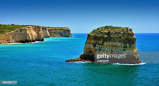 big rock over the sea - portimao stock photos and pictures