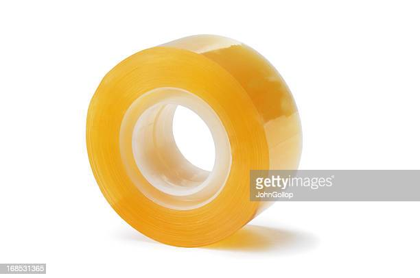 big role of adhesive tape isolated on white - rolled up stock pictures, royalty-free photos & images