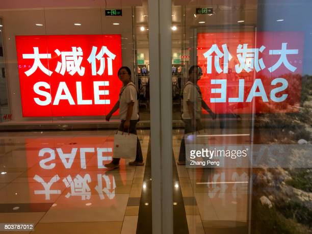 Big Sale lightbox in a shopping center Although China's GDP growth is slowing the size of China's consumption market is still increasing at an...