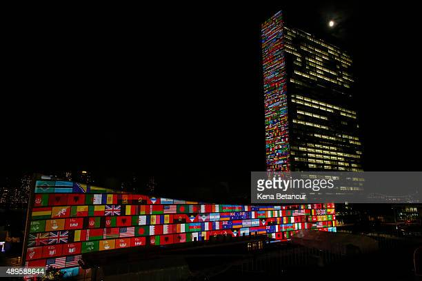 Big scale projections are seen over the general assembly building at United Nations headquarters on September 22 2015 in New York City The...