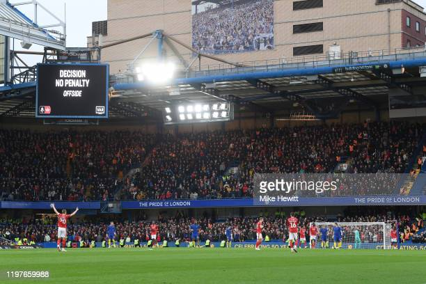 A big screen inside the stadium displays the decision of a VAR review for a possible penalty during the FA Cup Third Round match between Chelsea and...