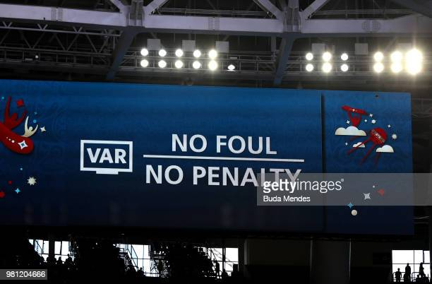 A big screen inside the stadium shows a VAR decision as a penalty awarded to Brazil is rescinded during the 2018 FIFA World Cup Russia group E match...