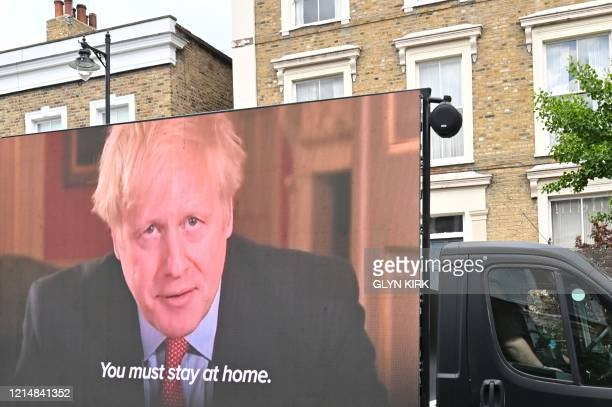 A big screen organised by British political campaign group Led By Donkeys mounted on a vehicle plays a clip from Britain's Prime Minister Boris...