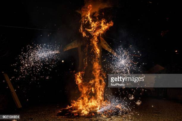 A big sculpture dressed as a Careto is burned after the parade symbolizing the burning of the old year in Salsas Portugal on Saturday January 6 2018...