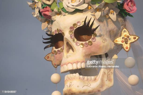 A big sculpure of a Catrina rests in the street of Zapotlanejo town during the Festival de la Muerte as part of the 'Day of The Dead' celebrations on...