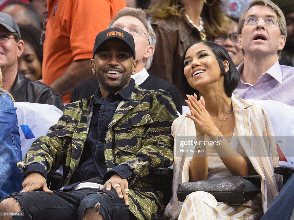 Big Sean (L) and Jhene Aiko attend a basketball game between the Boston Celtics and the Los Angeles Clippers at Staples Center on March 28, 2016 in Los Angeles, California.