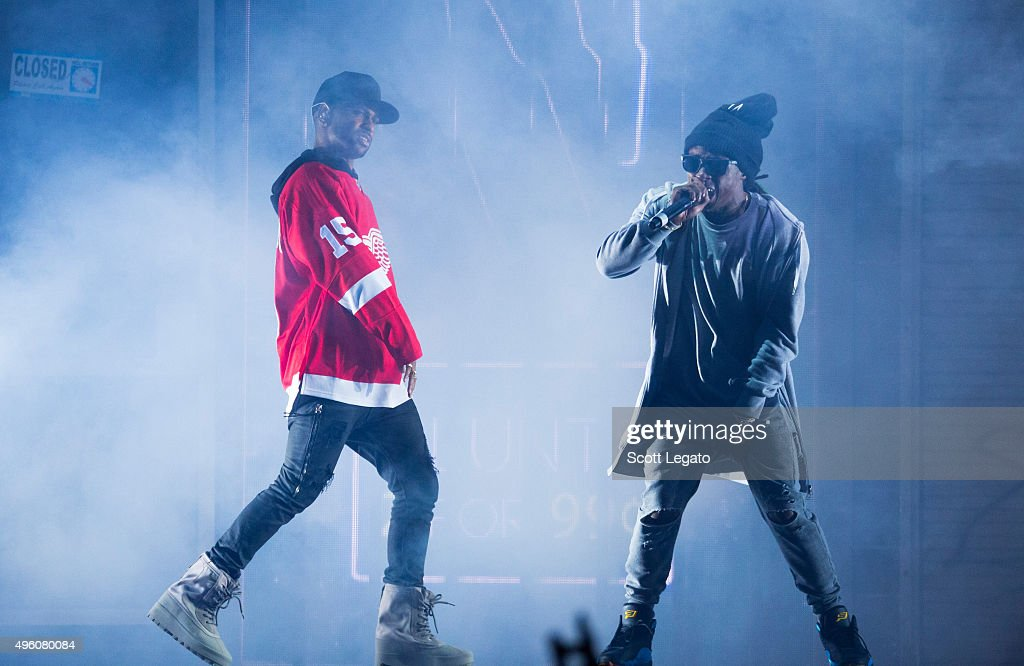 Big Sean (L) and with special guest Lil Wayne perform in concert in his hometown of Detroit at Joe Louis Arena on November 6, 2015 in Detroit, Michigan.