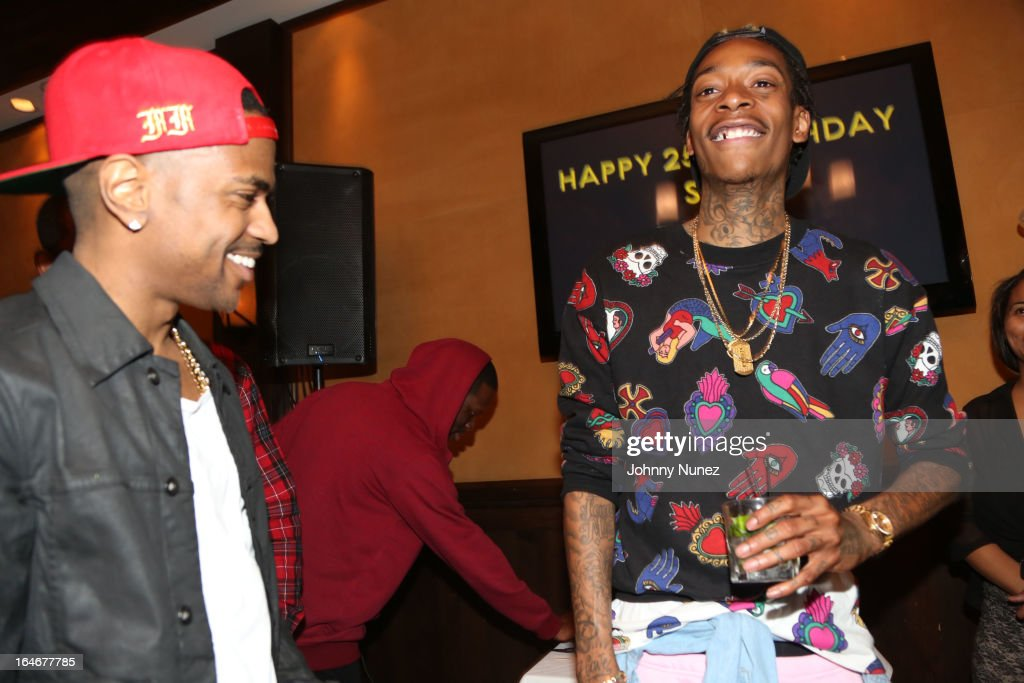 Big Sean and Wiz Khalifa attend Remy Martin V Celebrates Big Sean's 25th Birthday Dinner at Wolfgang's Steakhouse on March 25, 2013 in Beverly Hills, California.