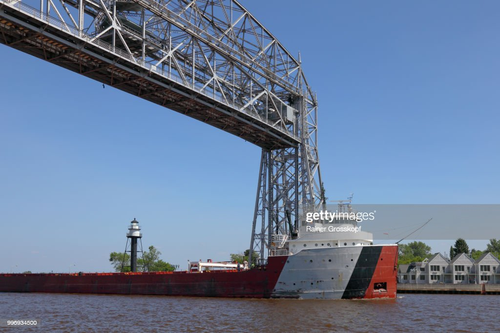 Big ship passing the aerial lift bridge in Duluth : Photo