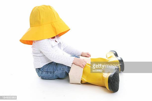 big shoe children: little girl in rain wear - yellow hat stock pictures, royalty-free photos & images