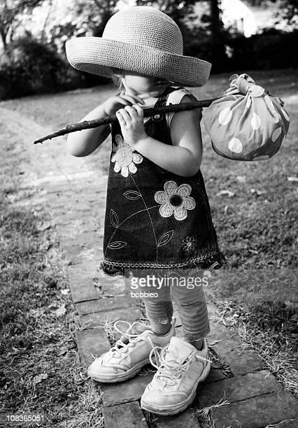 big shoe children: unrecognizable little girl with hobo luggage - big bums stock photos and pictures