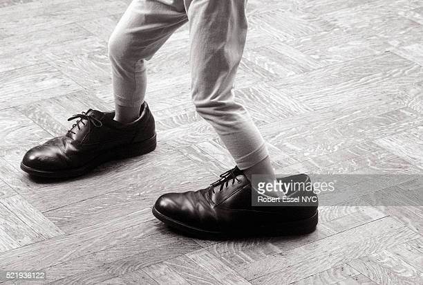 big shoe shuffle - big foot stock photos and pictures